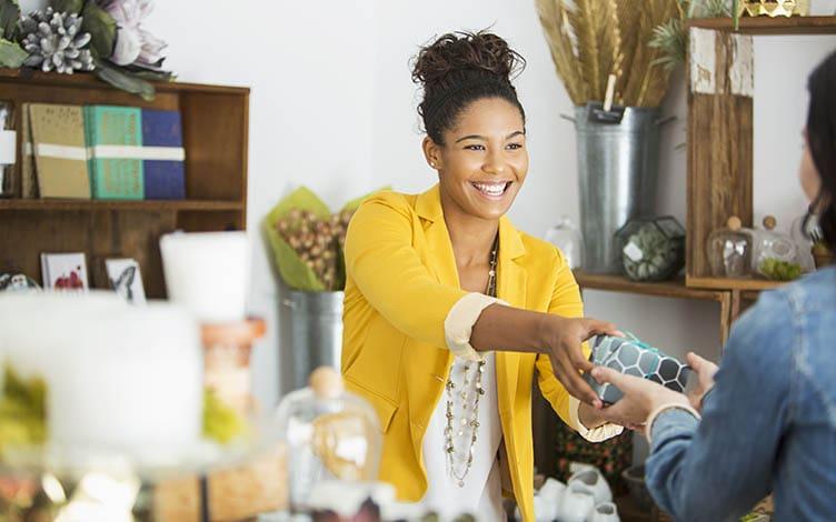 Saleswoman helping a customer
