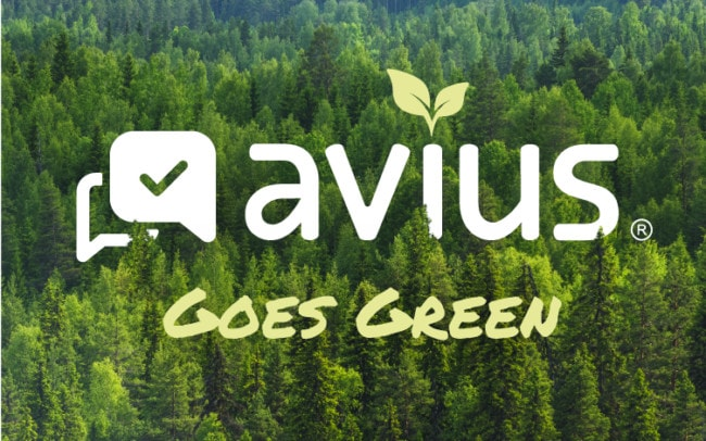 Avius Goes Green sign with forest in the background